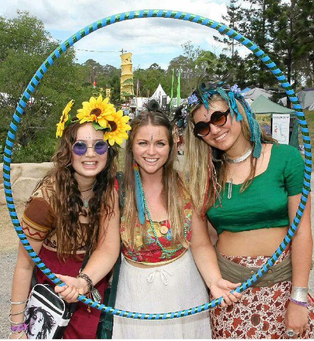 CIRCLE OF FRIENDS: Rosie Rayner, Tara Naismith Thompson, and Kalyani Mumtaz dress up for Day Two of Woodford Folk Festival.