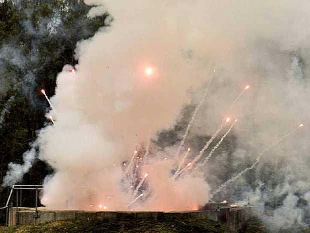 FIERY END: Illegal fireworks erupt from a bunker after being doused in diesel and set alight at the Helidon Explosives Reserve yesterday.