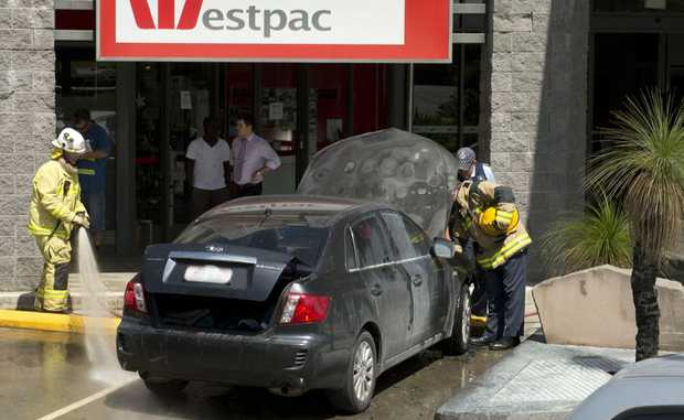 Emergency services attend The Ridge Shopping Centre where a car caught on fire.
