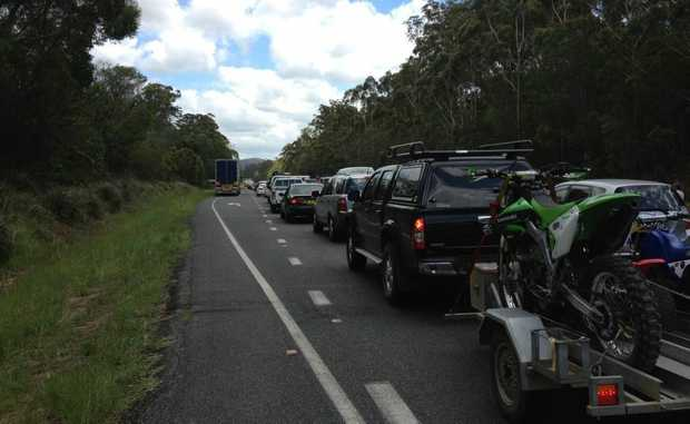 HIGHWAY BLOCKED: Traffic banks up on the Pacific Highway after a fatal headon collision north of the Iluka turnoff this morning. Photo: JoJo Newby.