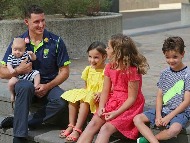 Michael Hussey of Australia holds his son Oscar as he talks to his daughters Jasmin and Molly and son William after a press conference on December 30, 2012 in Melbourne, Australia. Mike Hussey has announced that the third Vodafone Test against Sri Lanka in Sydney will be his last Test for Australia.