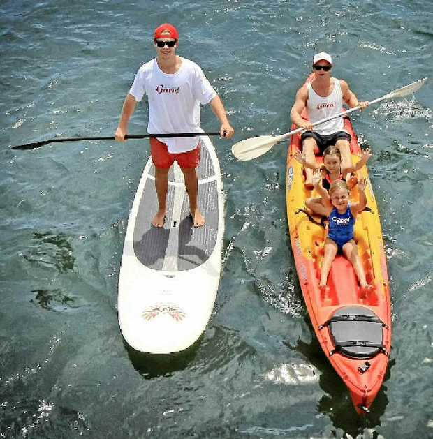 GURUS: Mick Munday takes Kaitlin, 7, and Zoe, 4, McMahon for a kayak while paddleboard expert Dean Kenny tags along.