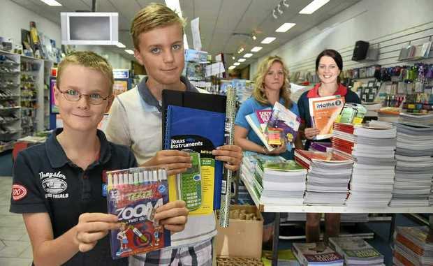 Benjamin and Jonathan Dekker check out the back to school supplies on offer at Hynes Newsagent, with the help of staff members Ashleigh Buckley and Hannah Lane.