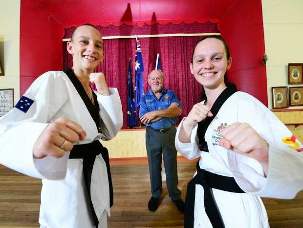 READY: Michael Kakakios and Petra Kakakios will compete in the US Open Taekwondo Championships next month thanks to the help of Toogoolawah RSL Club president Doug Cook (centre).