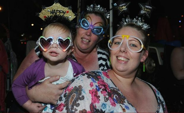 Lauren , 2, and Christine Fox and Pamela Parfitt from Ipswich at the New Year's Eve celebrations at Torquay.