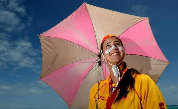 Patricia Commins at Coolangatta beach. Rain or Sunshine? Photo: John Gass / Daily News