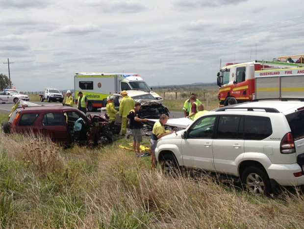 Emergency crews attend the scene of a two-car crash on the Warrego Highway, Gowrie Mountain.