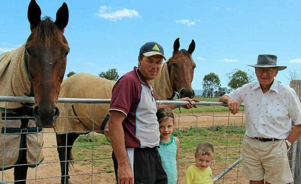 Doug Coy (right) and his grandson, Dayl March, with Dayl's two children, Mackenzie and Benjamin March. Dayl had two wins at the Toowoomba trots at the weekend.