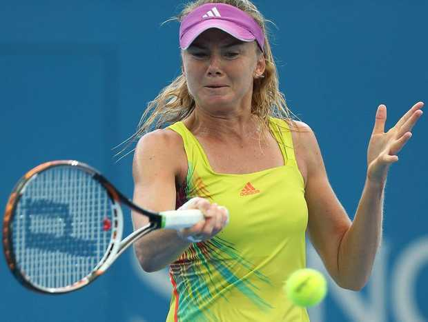 Daniela Hantuchova of Slovakia plays a forehand during her match against Sara Errani of Italy on day three of the Brisbane International at Pat Rafter Arena on January 1, 2013 in Brisbane, Australia.