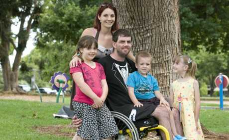 Brad Staggs broke his back when taking part in a charity motorbike ride. Now his family fiancee Karissa Lindemann and children (from left) Sara-Leigh, Bryce and Roxanne Staggs are raising funds for Careflight which helped him after his crash.