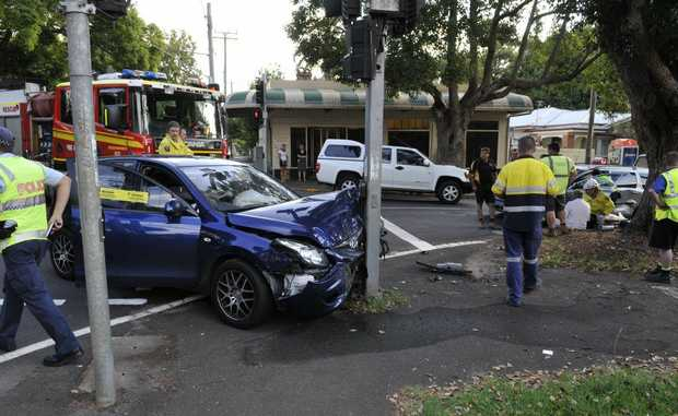 Emergency crews attend a two-car crash at the intersection of Hume and Campbell Sts.
