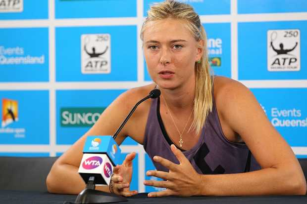 Maria Sharapova of Russia announces her withdrawal from the tournament on day three of the Brisbane International at Pat Rafter Arena on January 1, 2013 in Brisbane, Australia.