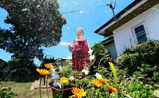 SPLASHING OUT: Ipswich Horticultural Society president Dawn Jones warns of higher costs as water restrictions end.