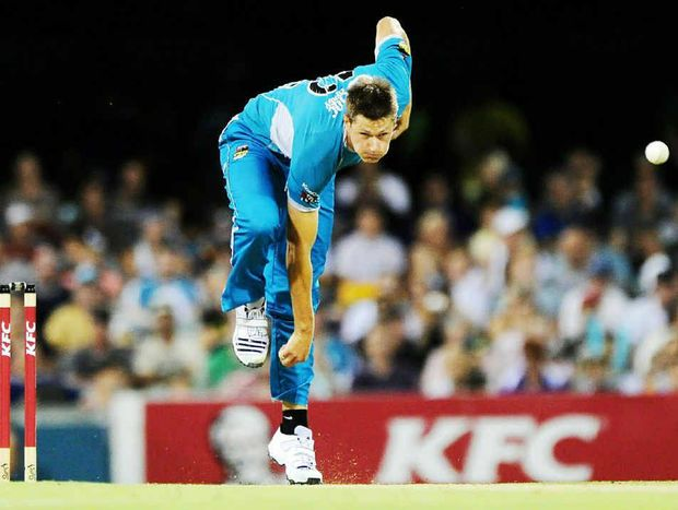 Cameron Gannon bowls during the Big Bash League match between the Brisbane Heat and the Hobart Hurricanes at The Gabba.
