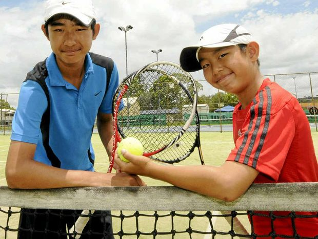 SPORTING HOLIDAY: Tennis-loving brothers Jie Dong, 14, and Chen Dong, 10, from Singapore, will be hoping to star at the Lismore Open Championships starting today.