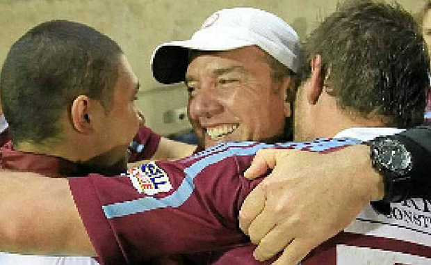 Coach Rob Brough celebrates with players.