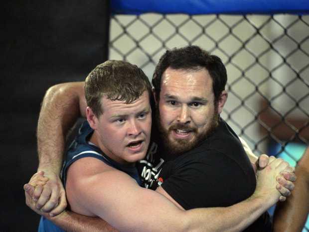 Part of the Sea Eagles pre season training involved an intense wrestling session. Matt Bowd and Brenton Stonier.