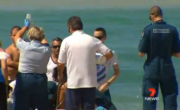 A man was found unconscious in the water at Kirra Beach.