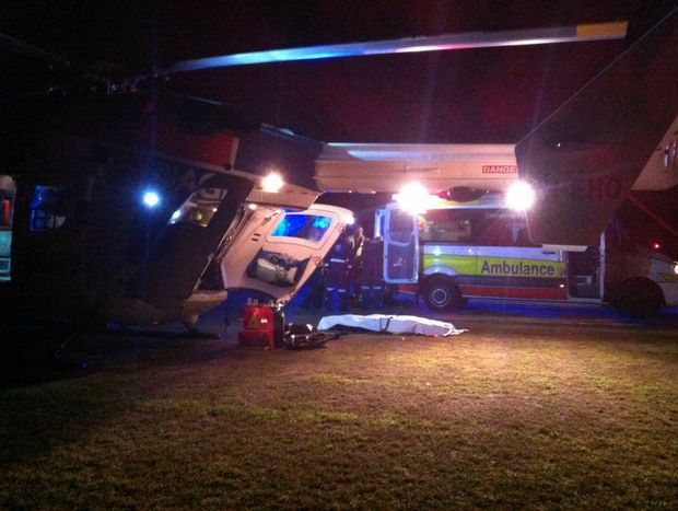 Two men on a motorcycle were injured in a head-on crash with a car at Glasshouse Mountains