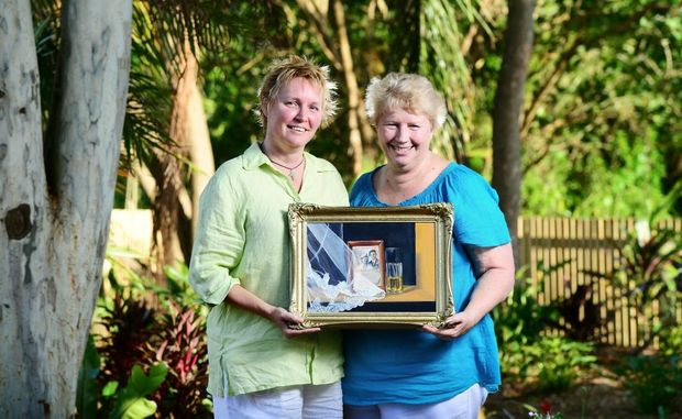 Artist Deb Mostert (left) is having an exhibition of her paintings of objects salvaged from the 2011 floods at the Ipswich Art Gallery. Pictured with Goodna flood victim and participant Margaret Kloostra.