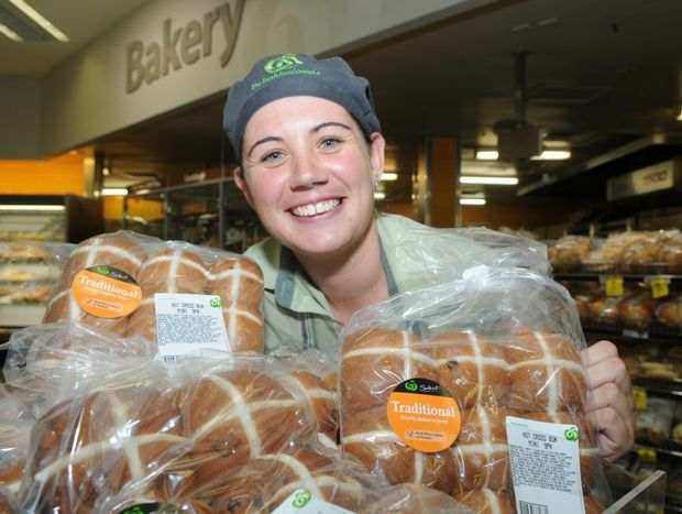 Woolworths Caneland Central baker Jackie Barker with a selection of hot cross buns that are now on sale.