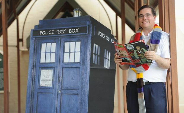 Father Paul Kelly with some of his Dr. Who collection.