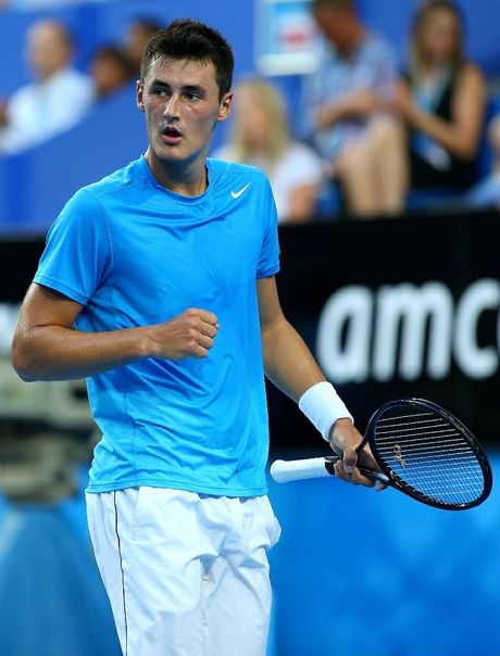 Bernard Tomic of Australia celebrates winning a point in his singles match against Novak Djokovic of Serbia during day five of the Hopman Cup at Perth Arena on January 2, 2013 in Perth, Australia.