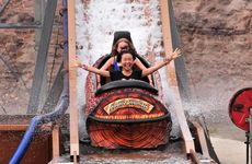 Eli Imaminato, 14, from Japan enjoys a soaking on the log flume ride at Aussie World, with Demi Woodford, 12, from Noosa behind. Photo: Iain Curry / Sunshine Coast Daily
