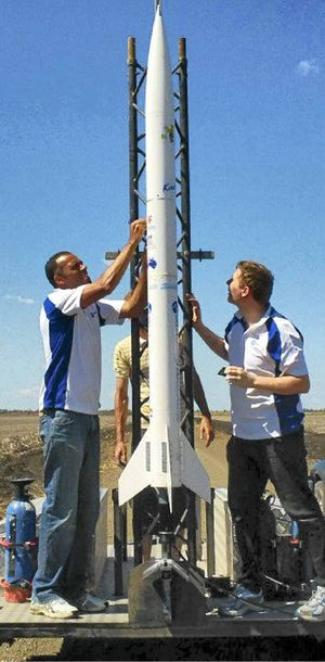 STRINGENT CHECKS: Academic Launch Initiative project manager Jamie Anderson (left) and Academic Launch Initiative member Wayne Taylor make final preparations for the launch of the RASTA rocket near Pampas.