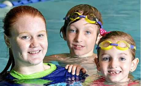 LEARNING EARLY: Lilly, 7, and Linkin Halliday, 9, with trainee swim instructor Dionne Buckely at McMahon's Swim Factory.
