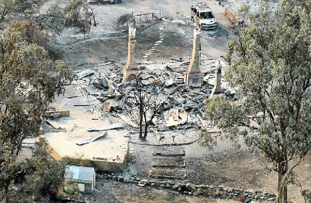 TERRIBLE SIGHT: A house damaged by a bushfire is seen from a helicopter in Dunalley, Tasmania, yesterday.