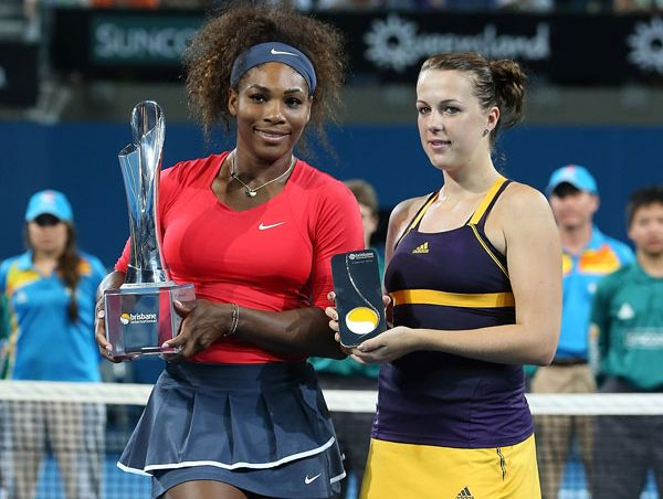 Serena Williams of the United States holds the winners trophy while her opponent Anastasia Pavlyuchenkova of Russia holds the runner up trophy after the womens final on day seven of the Brisbane International at Pat Rafter Arena