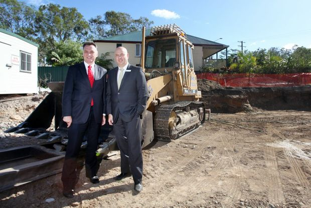 Craig Emerson and Jason Cubit at the new affordable housing site on North Road, Logan Central. Photo: Inga Williams / The Reporter