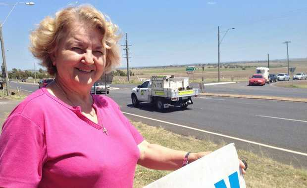 Zimms Corner service station owner Olga Marr in front of busy the intersection on the Warrego Hwy.