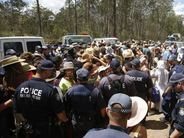 Police move protesters back along The Avenue as they close the road around the Glenugie CSG site. Photos: Adam Hourigan
