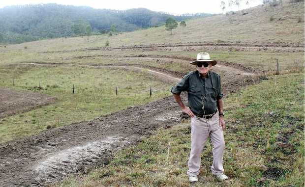 Fabian Webb checks out work on a natural amphitheatre for the inaugural Widgee Thornside Country Music Muster.