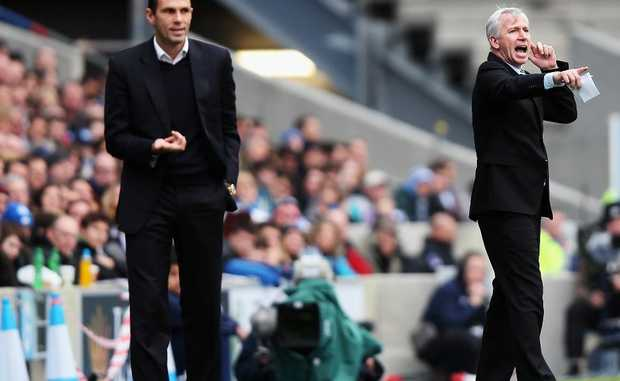 Newcastle United Manager Alan Pardew (R) instructs his team as Brighton & Hove Albion Manager Gus Poyet looks on, during the FA Cup with Budweiser Third Round match between Brighton & Hove Albion and Newcastle United at the Amex Stadium on January 5, 2013.