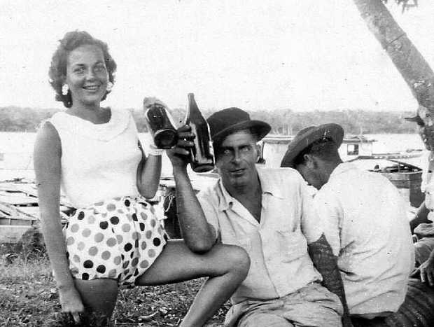 HERE'S CHEERS: Eileen Massoud enjoys a beer on the river with Phillip Massoud in the spot where Massoud Park is today.
