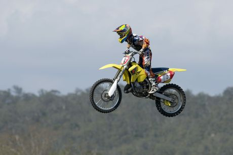 Kaleb Barham of the Toowoomba Motocross Club soars over a jump.