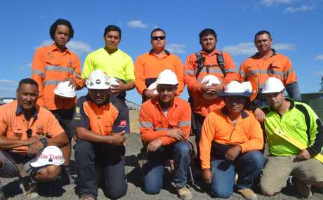 Kiwi construction contractors (back, from left) Wayne Faapito, Blake Kefu, Andrew Manu, Armine Kay, Ralph Williams, (front, from left) Tee Kefu, Mafi Kefu, Matthew Hapeta and Rob Leilua helped to lift a car off a man near Yuleba. They are pictured with fellow worker Ardelius Mitchell (front, far right).