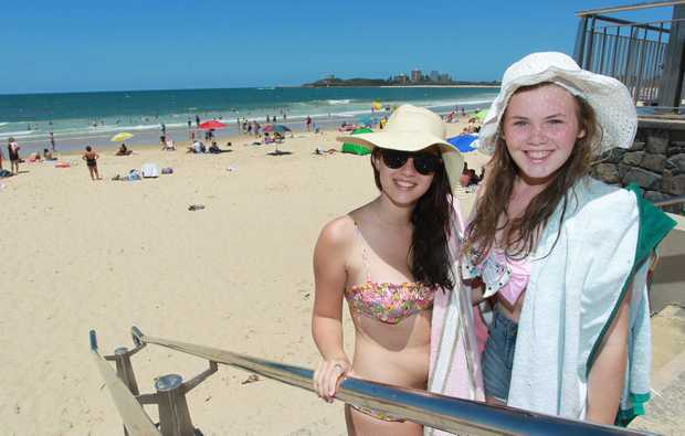 Caitlin Uittenbosch and  Abby Crowther, both from Brisbane, at Mooloolaba beach today.