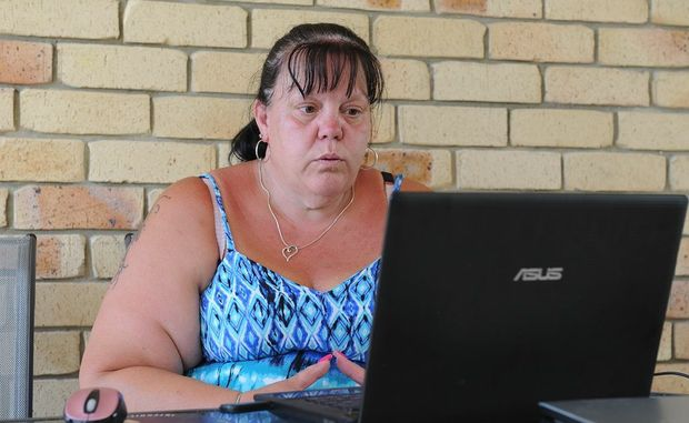 Kaye Edwards, the wife of missing man Hugh Edwards, waits by the computer for any news.