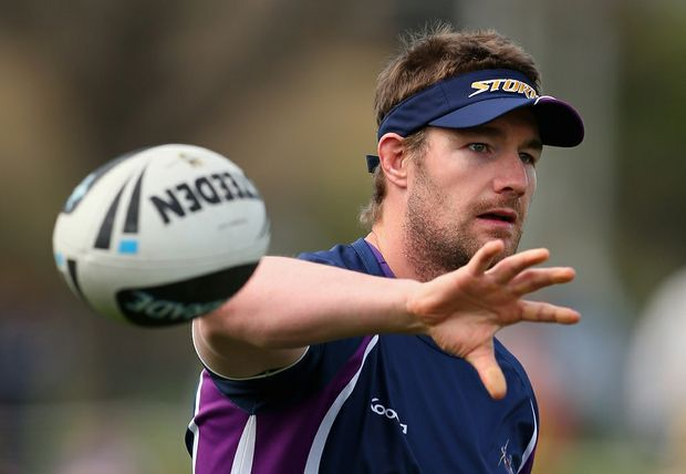 Anthony Quinn of the Storm passes the ball during a Melbourne Storm NRL training session at AAMI Park on September 25, 2012 in Melbourne, Australia.