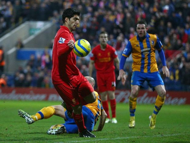 Luis Suarez of Liverpool appears to control the ball with his hand during the FA Cup with Budweiser Third Round match between Mansfield Town and Liverpool at One Call Stadium on January 6, 2013 in Mansfield, England.