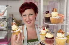 Heather Woodcraft of Crave Cupcakes with a maple-bacon cupcake.