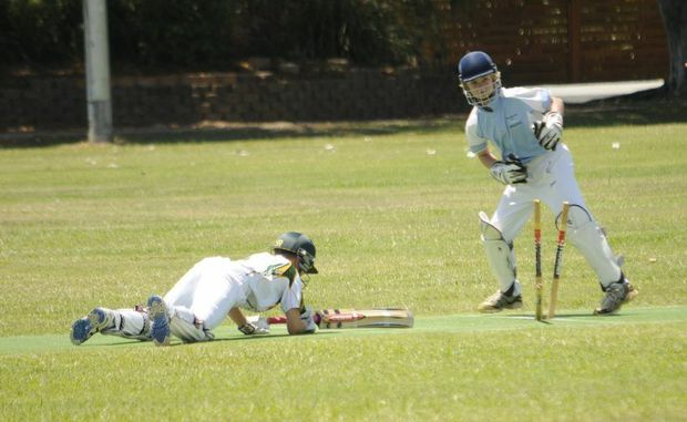 STUMPED: Ballina District wicket-keeper Matt Job stumps Hawkesbury batsman Bailey Thompson in an Under-13 cricket carnival game at Saunders Oval in Ballina on Tuesday. The event has brought several hundred people to Ballina. Photo Doug Eaton / The Northern Star