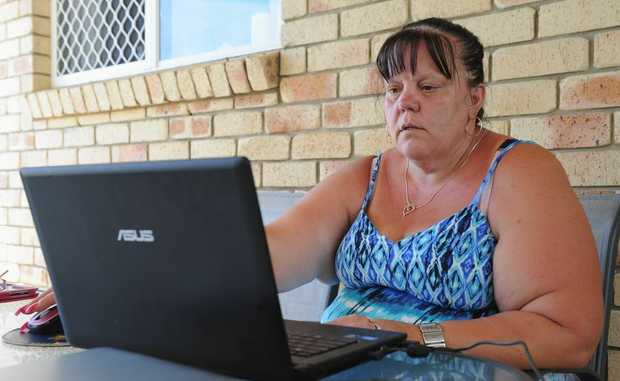 A distraught Kaye Edwards checks the computer for any news on her missing husband Hugh. The family is using social media in a bid to find the 52 year old.