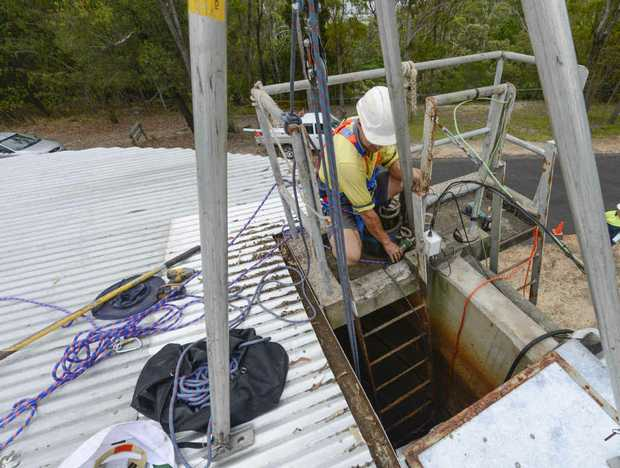 WATER ALERT: A Clarence Valley Council employee works on the lookout reservoir at Maclean. Photo Contributed