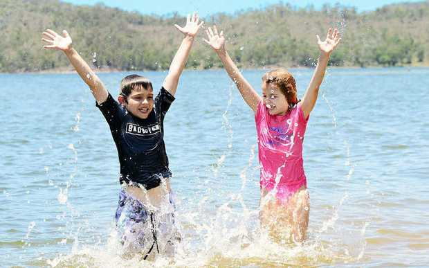 HAPPY DAYS: Eligh, 9, and Tahlia Salvietti, 7, of Coominya cool off at Wivenhoe Dam.