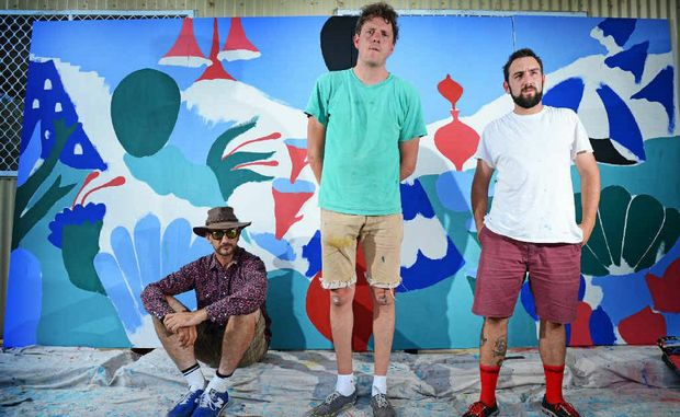 NICE TAG: Sydney artists Zap, Jumbo and Bafcat pictured with the work they have created for The Rainbow Power Company in Nimbin. Below are examples of their earlier artwork.